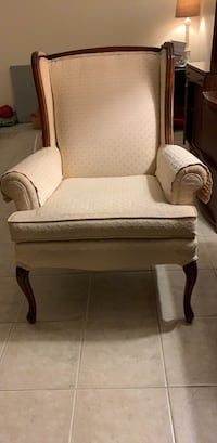 brown wooden framed white padded armchair Rockville, 20853
