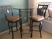 Bistro set, brass colored metal. New condition. Tall style. Glass top. You pick up in Olney, MD. Cash only.