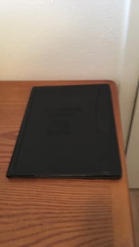 Black folder with note pad for.05 cents