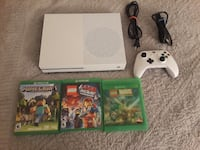white Xbox One console with controller and game cases PENSACOLA