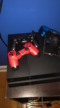 black Sony PS4 console with two controllers Washington, 20010