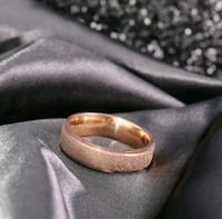 New 14kt rose gold / s. S. Wedding ring New Port Richey, 34652