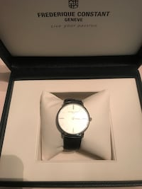 round silver analog watch with link bracelet in box