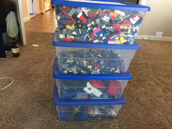 A whole collection of legos put together in one fir over 1000 pieces and the instruction books included