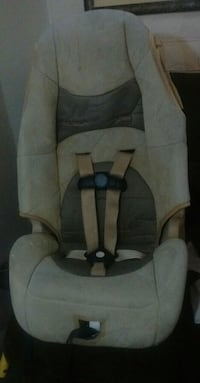 baby's white and brown car seat carrier