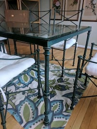 Glass table with green iron trim and 6 chairs Lorton