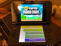 black Nintendo 3DS with game cartridge 568 mi