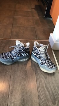 pair of white-and-black Nike Foamposite shoes Vancouver, V6Z 1N2
