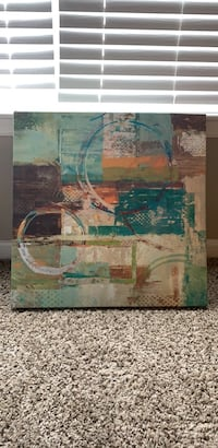 green, brown, and blue abstract painting
