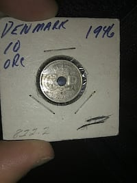 silver-colored commemorative coin Duluth, 55806