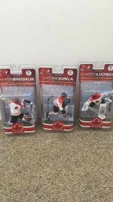 Three Canada hockey action figures