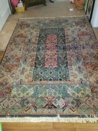brown, green, and red floral area rug