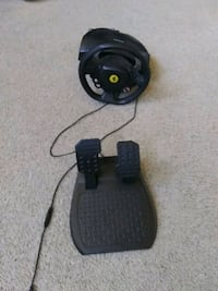 Xbox 360 steering wheel and pedal set.