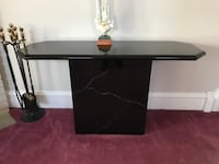 black and white wooden TV stand/sofa table