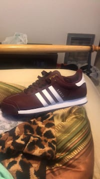 Pair of burgundy and white adidas low-top size 11 sneakers