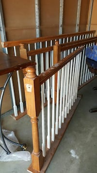 brown and white wooden hand rails