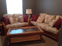 Brown wooden framed brown fabric padded sofa