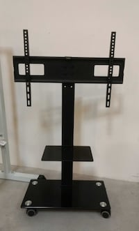 """Brand new tv stand on wheels universal fits 32"""" to 65"""" tv sizes plasma lcd flat screen  Los Angeles, 90032"""