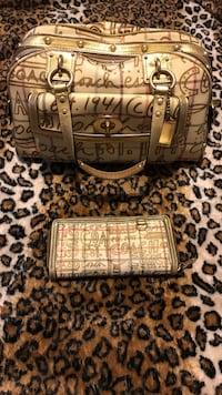 Large gold coach purse and matching large wallet.