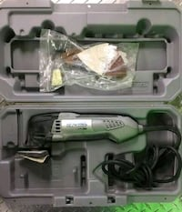 green and black Hitachi corded angle grinder with case Memphis