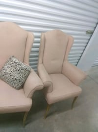 Two Peach cream wingback chairs Lounge office