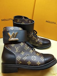 brown-and-black Louis Vuitton leather cap-toe boots 788 km