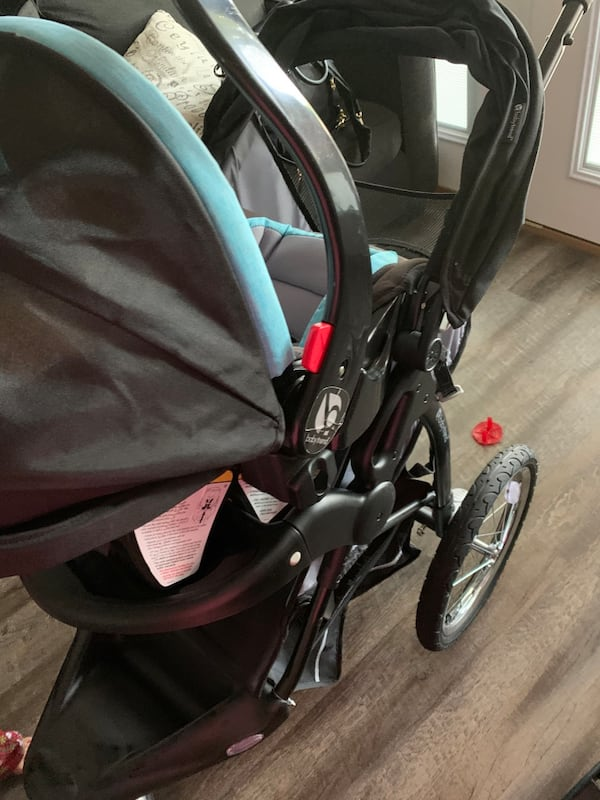 Two baby essentials babytrend stroller and car seat removable  ff97fb92-224f-4f8c-a26a-5a98a0801954