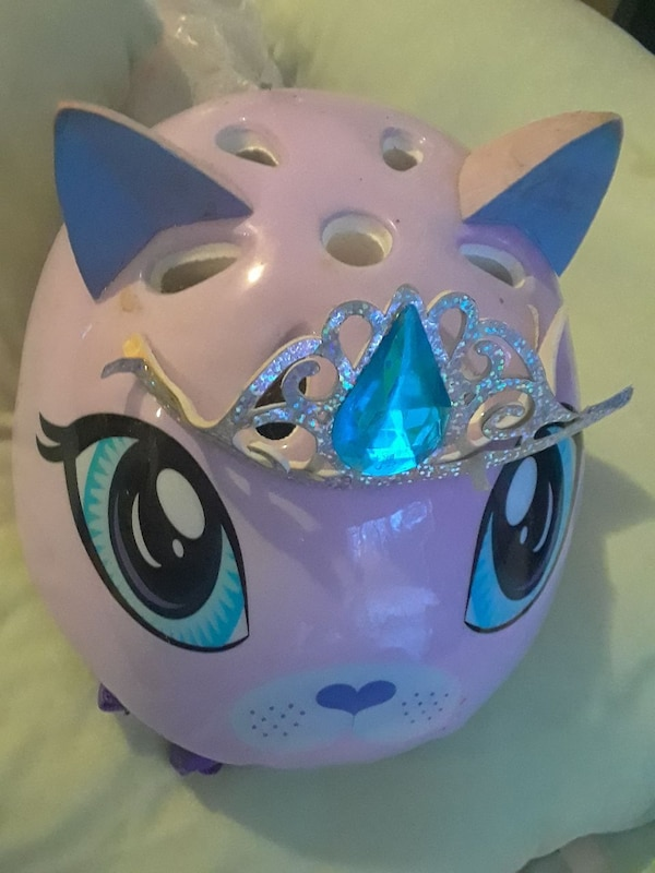pink cat wearing tiara figurine