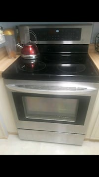 white and black induction range oven 798 mi