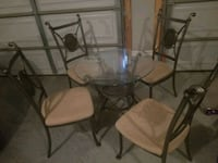 round glass top table with four chairs Springfield