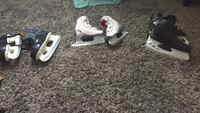 Two pairs of black and one pairs of white ice hockey skates Vaughan, L4L 1T3