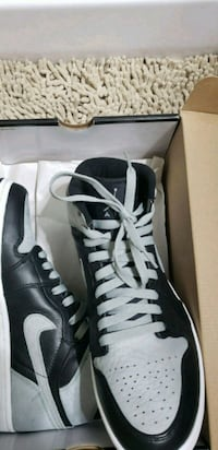 pair of black-and-white Nike cleats Rockville, 20850
