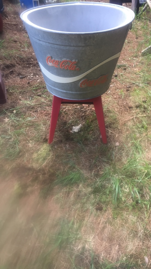 Photo Coca Cola cooler about 4 ft tall real galvanize barrel attached to a 4 leg steel frame insulated liner great shape