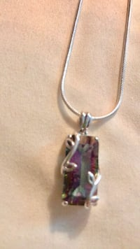 "A gorgeous ""mystic amethyst"" .925 pendent that comes with the sterling silver necklace. Brand new. 20"" long necklace Harahan, 70123"
