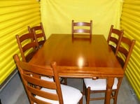 rectangular brown wooden table with six chairs dining set Colorado Springs, 80908