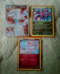 four assorted Pokemon trading cards Burnaby, V5A 3R5