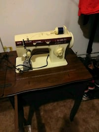 black and white electric sewing machine Midway, 31320