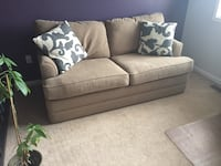 Apartment size sofa with pillows