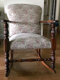 Antique upholstered rolling chair im great condition