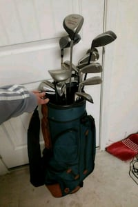 black and red golf bag with golf clubs Houston, 77090