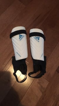 pair of white-and-black Nike shin guards Calgary, T3G 4G2