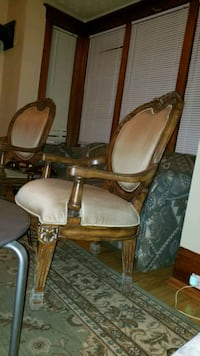 pair of Louis XVI oval back arm chairs