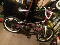 toddler's black, white, and pink bicycle