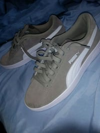 pair of gray-and-white Puma sneakers 505 mi