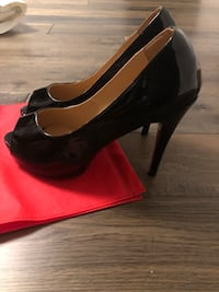 Pair of black leather platform stiletto shoes with red bottom Toronto, M6B 3W4