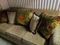 gray couch with five throw pillows