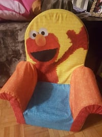 blue, red, and yellow Elmo sofa chair