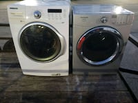 two white front-load clothes washer and dryer set 165 mi