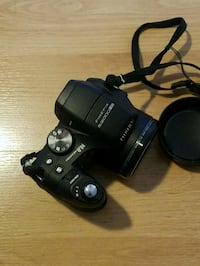 black Fuji Finepix 52000 DSLR camera