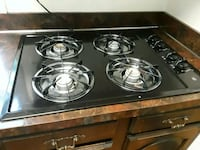 black and gray 4-burner gas stove 19×28 43 km